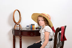 Little girl playing dress up Stock Images
