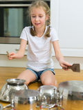 Little girl playing drums. Royalty Free Stock Photos