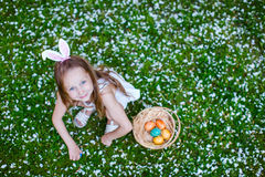 Little girl playing with Easter eggs Stock Image