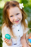 Little girl playing with Easter eggs Stock Photos