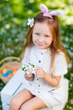 Little girl playing with Easter eggs Royalty Free Stock Photos