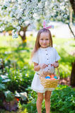 Little girl playing with Easter eggs Royalty Free Stock Image
