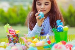 Little girl playing with Easter eggs stock photo