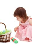 Little girl playing with eater eggs Royalty Free Stock Images
