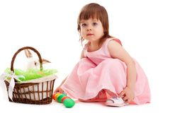 Little girl playing with eater eggs Stock Images