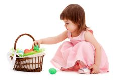 Little girl playing with eater eggs Royalty Free Stock Photography