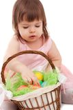 Little girl playing with eater eggs Stock Photo