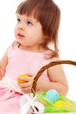 Little girl playing with eater eggs Stock Image