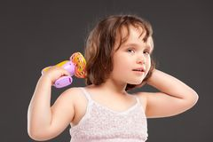 Little girl playing with fan stock photos