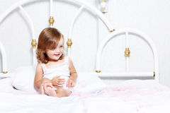 Little girl playing with feathers Royalty Free Stock Images