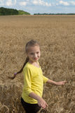 Little girl playing in a field. Gentle sunny day. Royalty Free Stock Photos