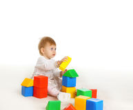 Little girl playing on the floor Royalty Free Stock Photography