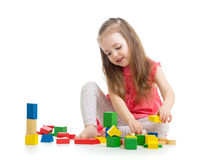 Little girl playing on floor at home Royalty Free Stock Image