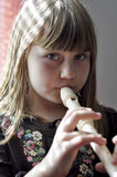 Little girl playing the flute Royalty Free Stock Images