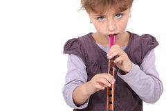 Little girl playing flute Stock Image