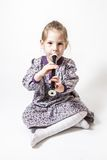 Little Girl Playing The Flute Royalty Free Stock Image