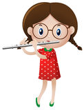 Little girl playing flute Royalty Free Stock Image