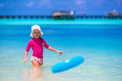 Little girl playing with flying disc at white Stock Photography