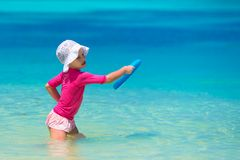 Little girl playing with flying disc at white Royalty Free Stock Image