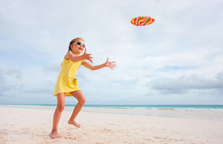 Little girl playing with flying disk Royalty Free Stock Photos