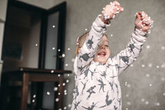 Little girl is playing with foam balls Stock Image