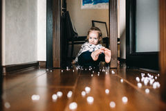 Little girl is playing with foam balls Royalty Free Stock Photography