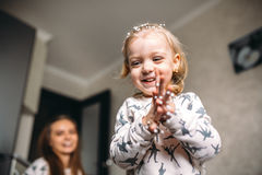 Little girl is playing with foam balls Royalty Free Stock Images