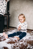 Little girl is playing with foam balls Stock Photo