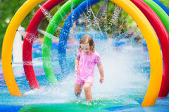 Little girl playing with fountain Royalty Free Stock Photography