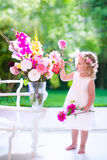 Little girl playing with fresh flowers Royalty Free Stock Photo