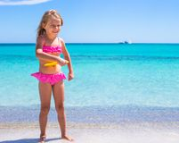 Little girl playing frisbee during tropical Royalty Free Stock Images