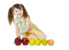 Little girl playing with fruits Royalty Free Stock Images