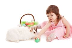 Little girl playing with fur eatser rabbit Stock Image