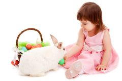 Little girl playing with fur eatser rabbit Royalty Free Stock Image