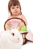 Little girl playing with fur eatser rabbit Stock Images