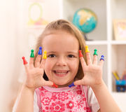 Little girl playing with game pieces stock photos
