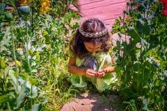Little girl playing garden Stock Photos