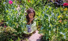 Little girl playing garden Royalty Free Stock Photo