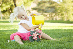 Little Girl Playing Gardener with Her Tools and Flower Pot Royalty Free Stock Photo