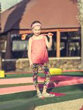 Little girl playing golf Royalty Free Stock Photos