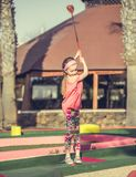 Little girl playing golf Royalty Free Stock Image