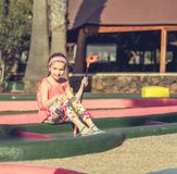 Little girl playing golf Stock Photo