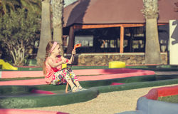 Little girl playing golf Royalty Free Stock Photography