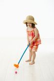 Little girl playing golf indoor Royalty Free Stock Images