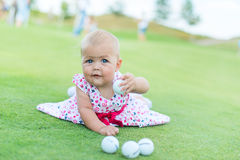 Little girl playing golf Stock Photography