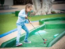 Little girl playing golf Royalty Free Stock Images