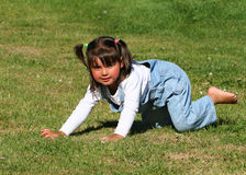 Little Girl Playing on the Grass royalty free stock photo