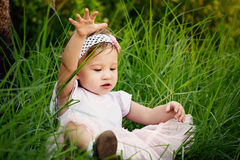 Little Girl Playing in the Grass Stock Photography