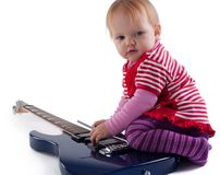 Little girl playing with guitar Royalty Free Stock Photos