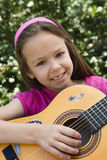 Little Girl Playing Guitar Royalty Free Stock Image